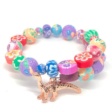 Load image into Gallery viewer, Gold Apatosaurus Dinosaur Little Girls Wrap Bracelet with Clay Floral Beads.