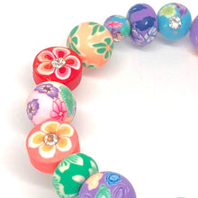 Load image into Gallery viewer, Blue Stegosaurus Dinosaur Little Girls Wrap Bracelet with Clay Floral Beads.
