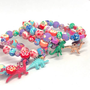 Blue Stegosaurus Dinosaur Little Girls Wrap Bracelet with Clay Floral Beads.