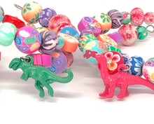 Load image into Gallery viewer, Pink Apatosaurus Dinosaur Little Girls Wrap Bracelet with Clay Floral Beads.
