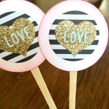 Load image into Gallery viewer, Gold black and white striped glittery heart cupcake toppers. Love. Wedding decor. Valentine's Day. Anniversary cupcake picks.
