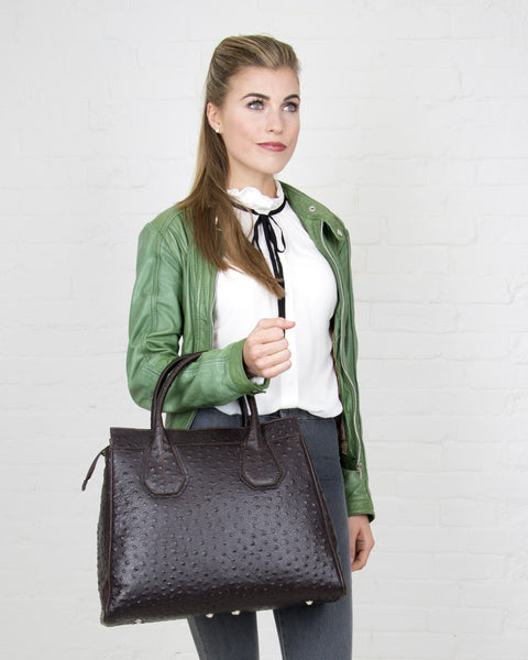 young lady with leather bag