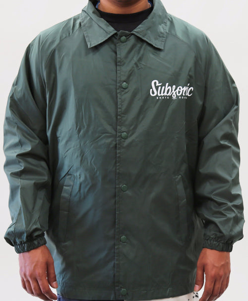 Subsonic Skateboard dark green jacket front with logo on upper left chest