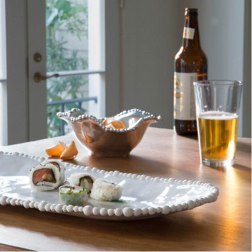 Beatriz Ball - VIDA Alegria Large Oval Tray White - LARGE on table with sushi on plate with beer in background