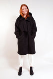 Heavy weight unlined wool parka. Loose fit, knee length, drawstring waist, hidden buttons, large loose hood, handwarmer chest pockets and waist pockets.   100% Boiled Wool. Heather Charcoal.