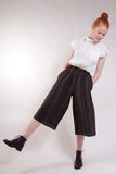 Elastic waist, slant pockets, wide leg, loose comfy fit. 100% Linen. Black with Olive stripes.