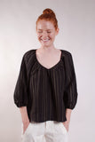 Gathered V neck puff sleeve top. Great everyday thrown on. 100% Linen. Black with Olive stripes.
