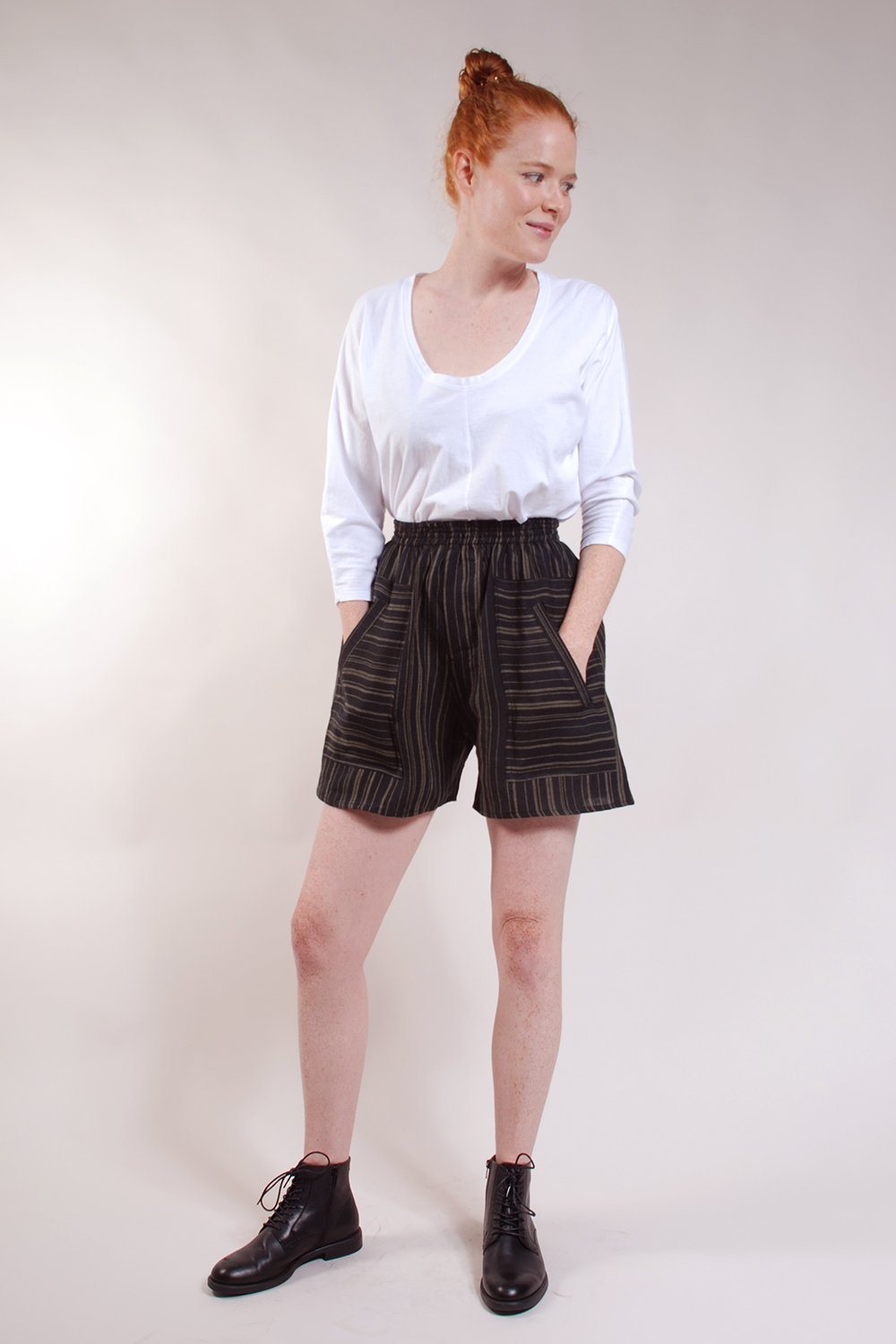 Elastic waist, welt patch pockets, center back gusset. 100% Linen. Black with Olive stripes.