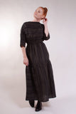 Boatneck dress with 3/4 sleeves, elastic shirred waist, drop hip gathered flouncy skirt. 100% Linen. Black with Olive stripes.