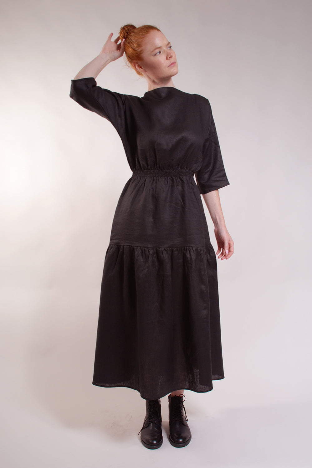 Boatneck dress with 3/4 sleeves, elastic shirred waist, drop hip gathered flouncy skirt. 100% Linen.