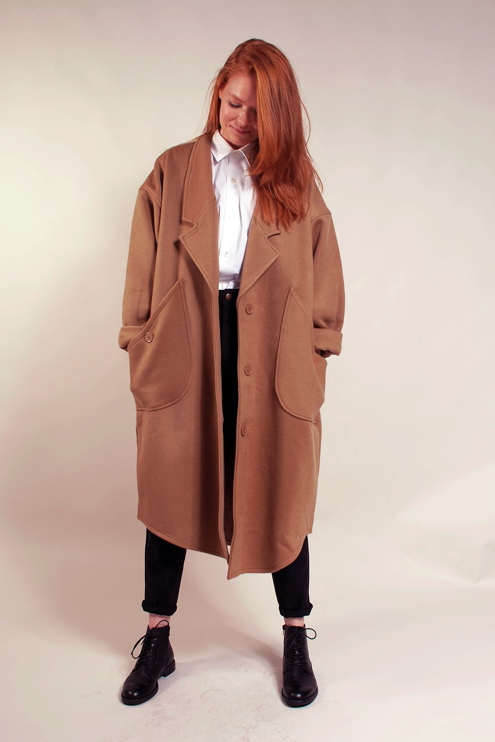 Kim Basinger in 9 1/2 weeks - soho gallery owner vibe -  overcoat. Shaped hem, rolled up sleeve, patch pockets.  One Size. Unlined. Great mid-weight coat! Very soft and heavy 96% Wool/4% Polyester.