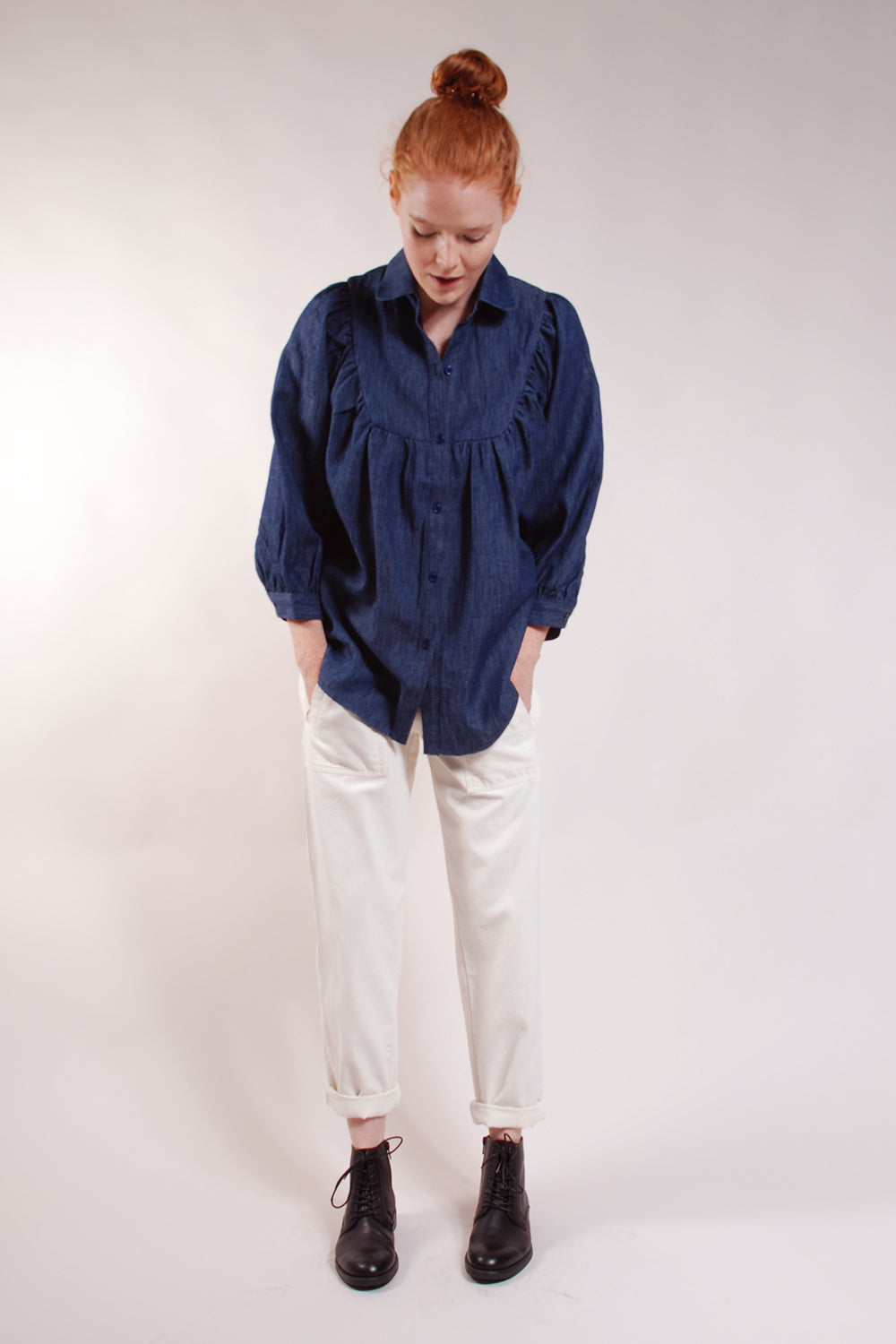 Gathered top, bracelet length sleeves, front and back yokes. Super soft washed denim. 100% Cotton.