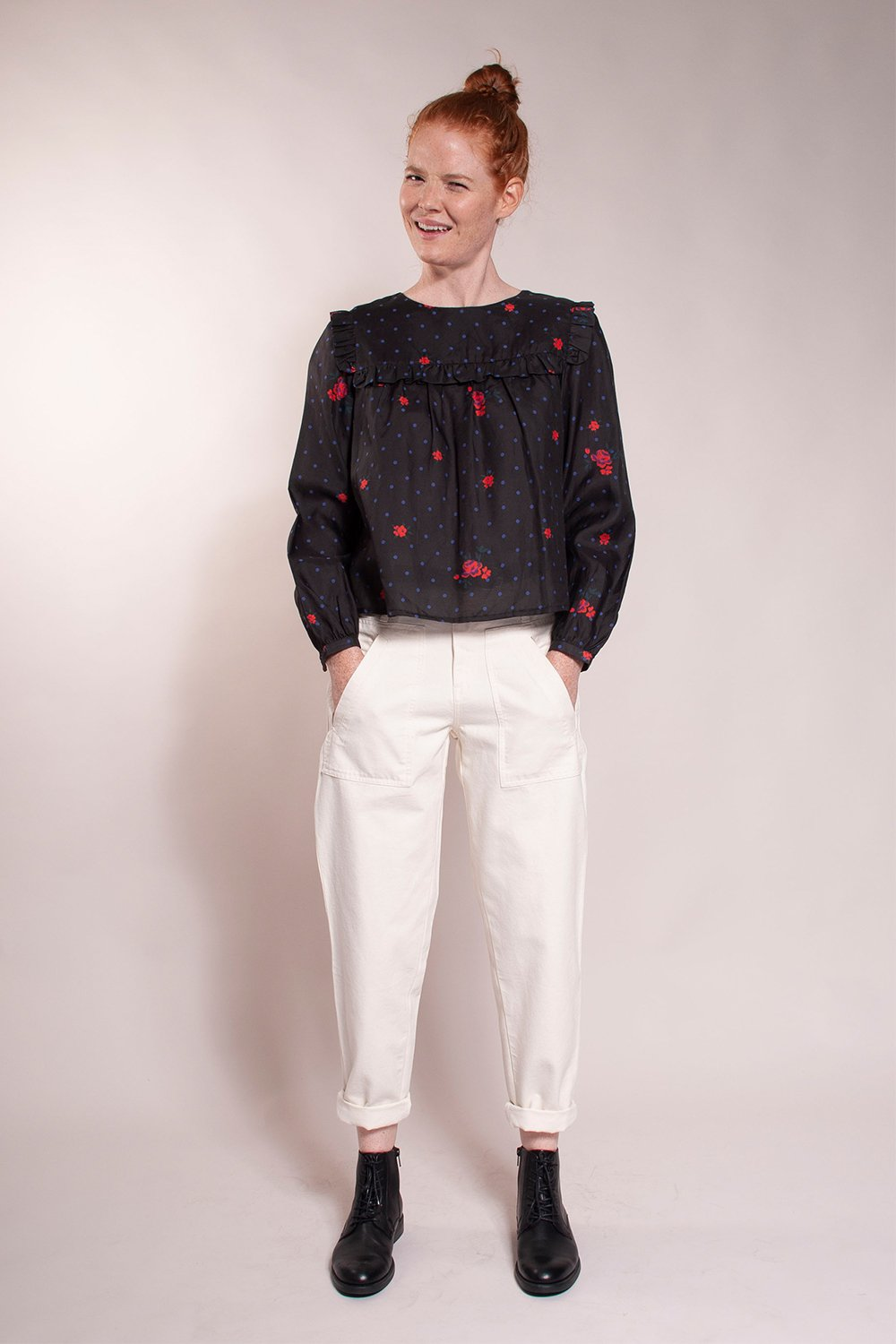 Ruffle yoke, 3/4 puff sleeves, single button back, waist length blouse. 38% silk/ 62%  cotton. Built by Wendy proprietary print.