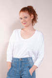 Super soft preshrunk 100% cotton jersey. 3/4 dolman sleeve, deep flattering U neck, and shaped hem. Great shape!