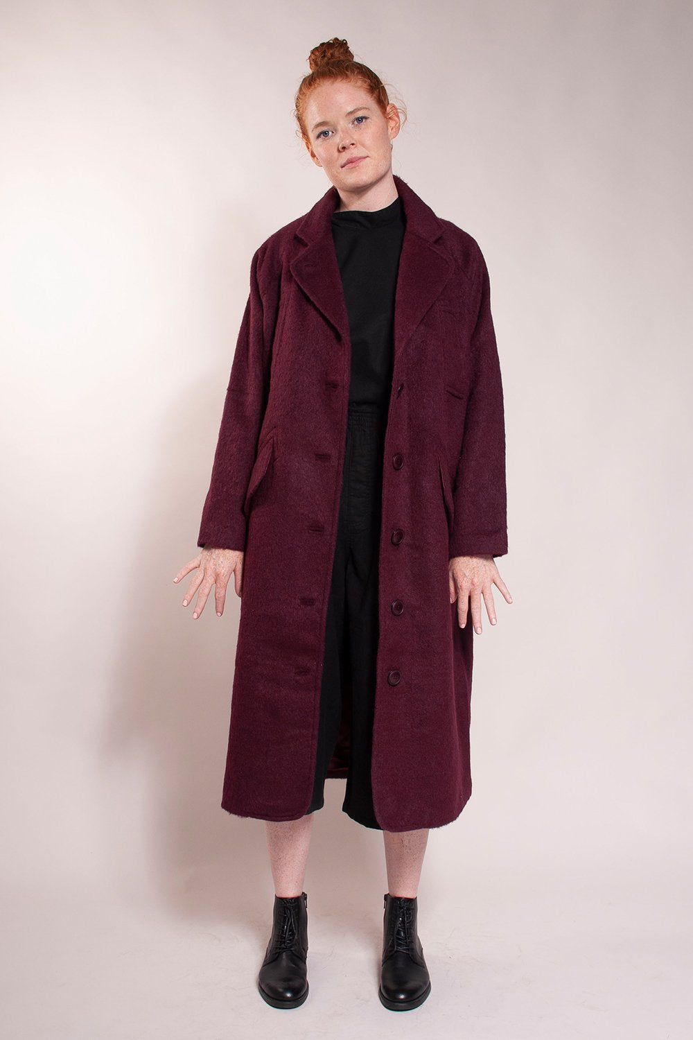 Long overcoat, loose fit, welt chest handwarmer pockets and hidden button hip pockets.30% Wool/ 70% Polyester. Fully lined.  Great mid-weight coat!