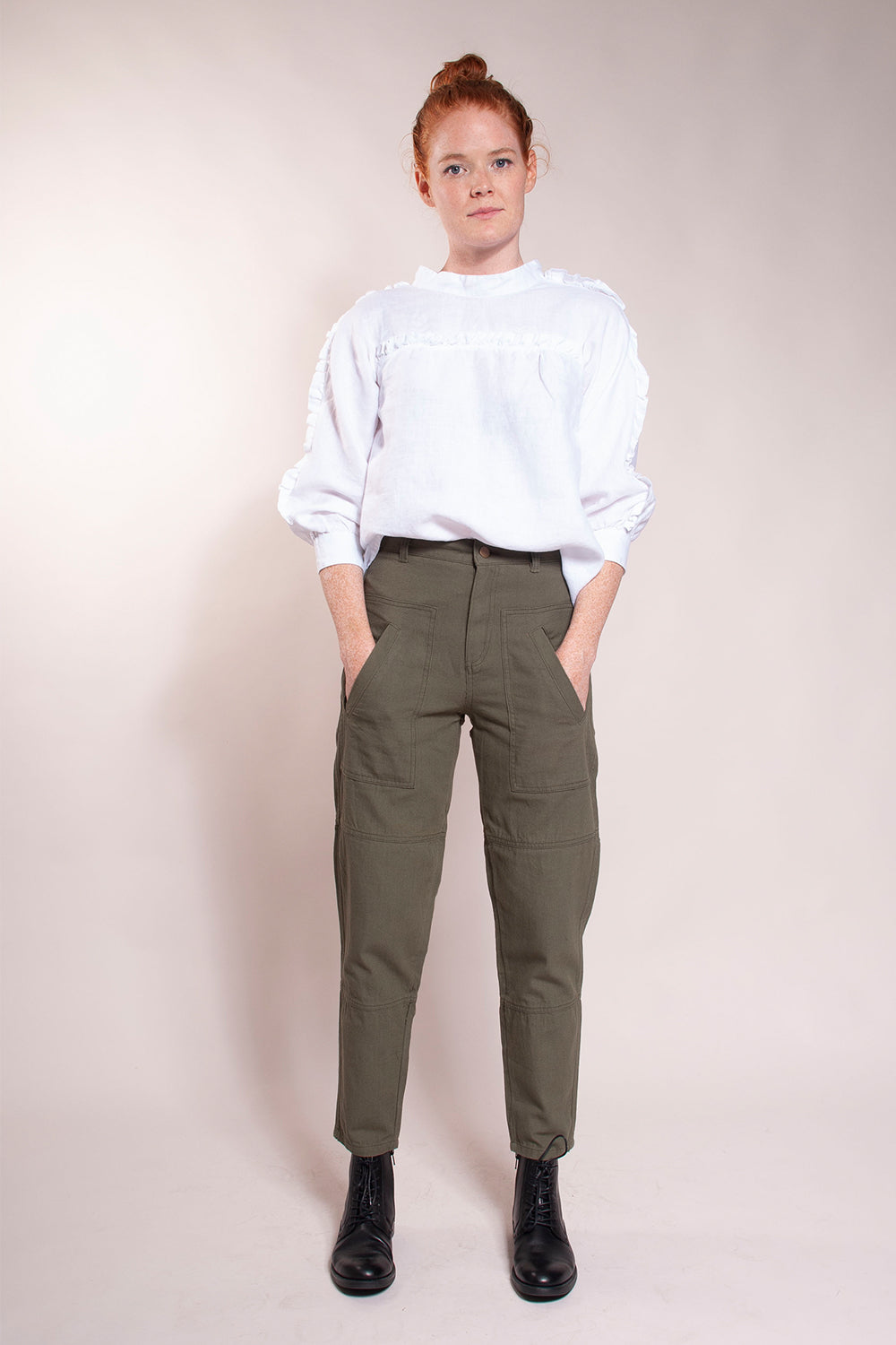 "High waist,  tapered cropped ankle.  Updated 80's fit.  Front patch pockets with slanted welt opening.  Back patch pockets.   Seams at knee. 28"" Inseam.  100% cotton canvas. Inseam is 28"". Model is wearing size 27."