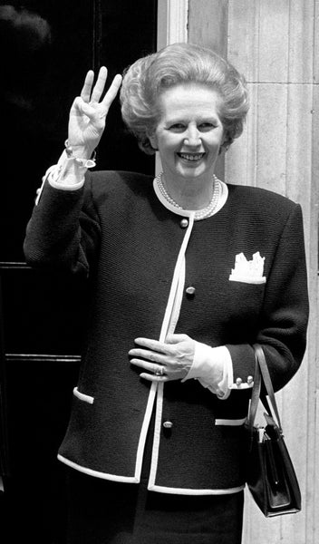 Margaret Thatcher is wearing cufflinks