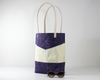 Purple Waxed Canvas Tote Bag, Side View with Prop | Madi May Design
