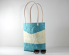 Blue Waxed Canvas Tote Bag, Side View with Prop | Madi May Design