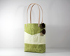Green Waxed Canvas Tote Bag, Side View with Prop | Madi May Design