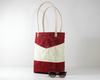 Red Waxed Canvas Tote Bag, Side View with Prop | Madi May Design