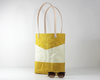 Yellow Waxed Canvas Tote Bag, Side View with Prop | Madi May Design