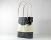 Grey Waxed Canvas Tote Bag, Side View with Prop | Madi May Design