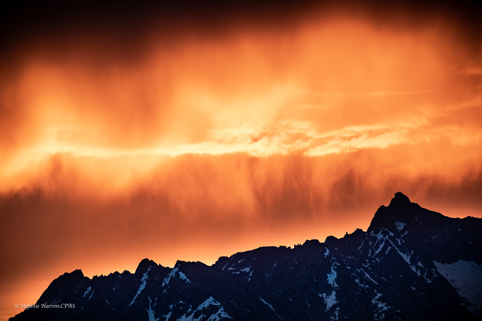 Fire Sky Sunrise over The Purcell Mountains through the thunderstorm