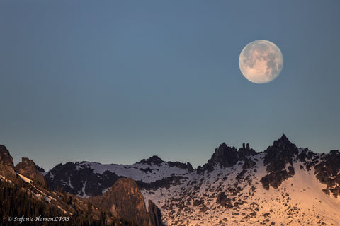 Moon setting over mountains of Kokanee Glacier Provincial Park