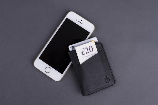 Slim Full Grain Leather Card Wallet for Men next to iPhone.