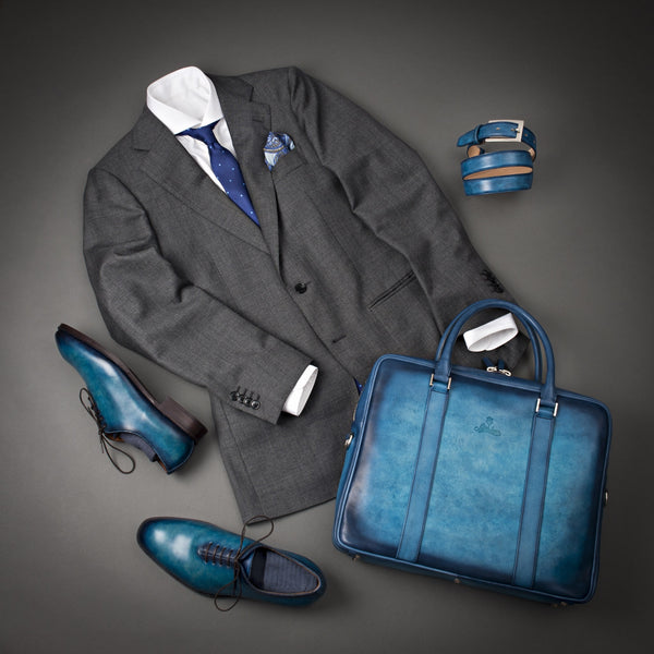 Elegant Outfit With Grey Suit, White Shirt, and Hand Patina Belt and Briefcase.