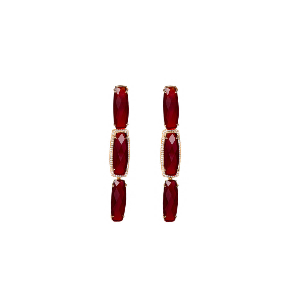 Baguette Shape red crystals in 18k Gold frame. Three inches long.