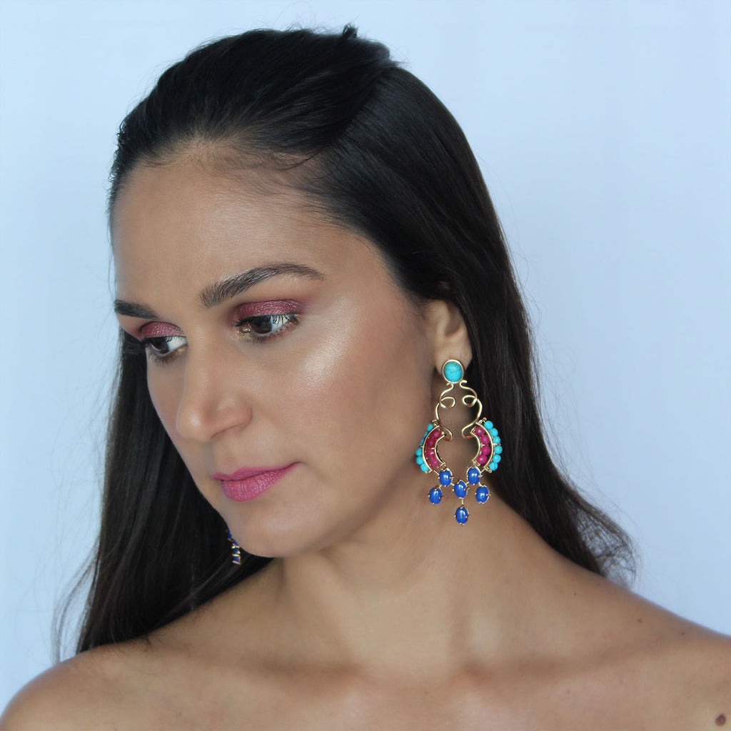 Statement earrings on model