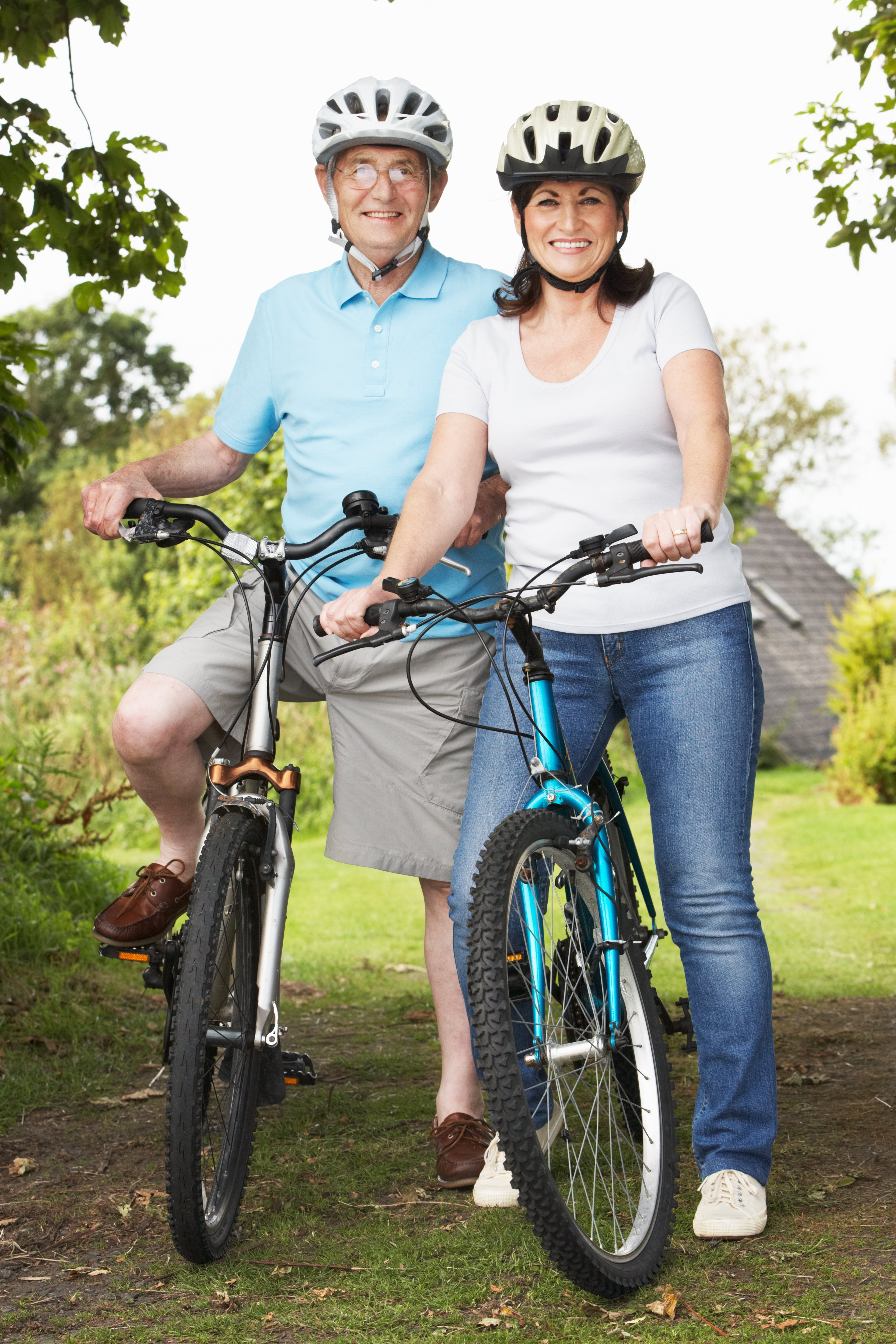 man and woman on bicycles smiling