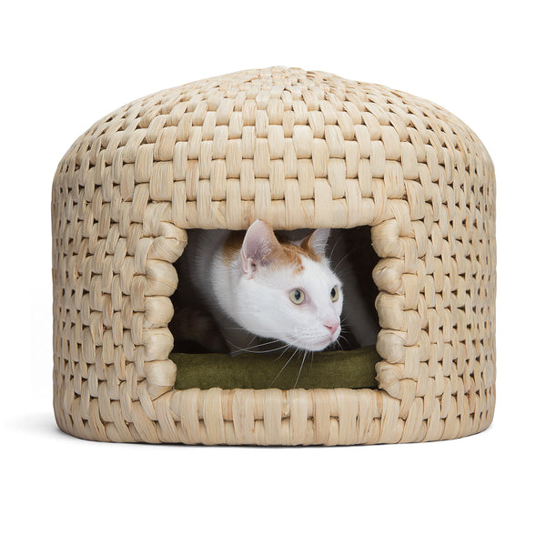 Cat peeking out from eco friendly handwoven neko chigura straw cat bed house