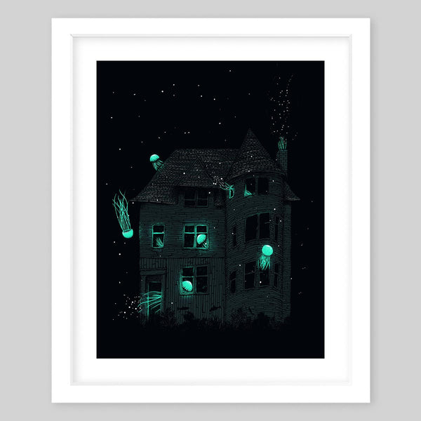 White framed art print illustrating a spooky house with glowing jellyfish throughout