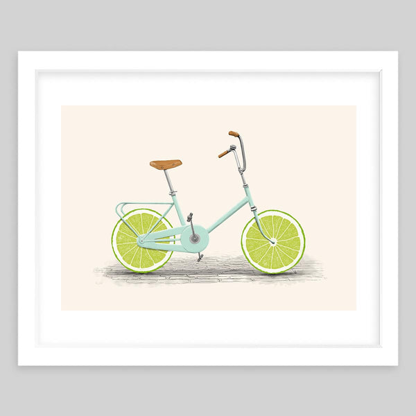 White framed art print of a vintage bicycle with limes as the wheels