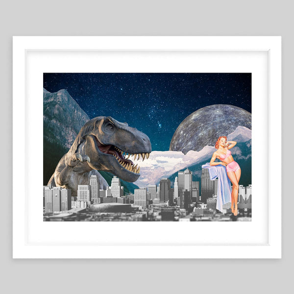White framed art print in a collage showing a dinosaur hovering over skyscrapers and a 50's model with a mountain background