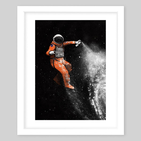 White framed art print of an astronaut in space creating stars with spray paint