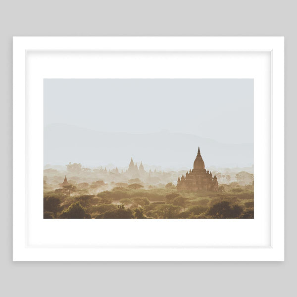 White framed art print photography of an overview of a town with a temple in the distance