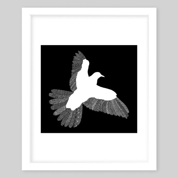 White framed art print illustrating a bird silhouette contrasting a dark background