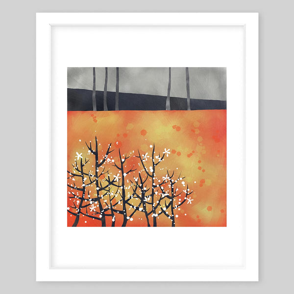 White framed art print of a forest showing gloomy trees in the top section followed by a bright orange background and trees with snowflakes in the corner
