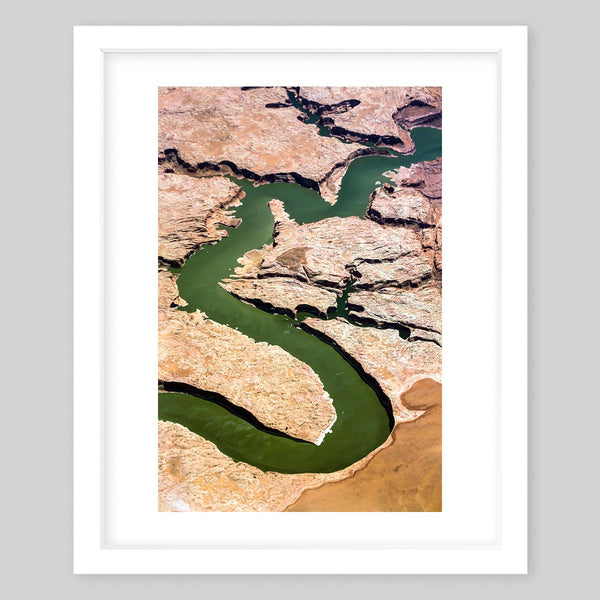 White framed art print of a photograph of a pathway through trails in nature