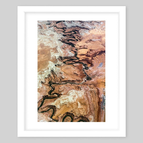 White framed art print of a photograph of a trail marked somewhere on a mountain