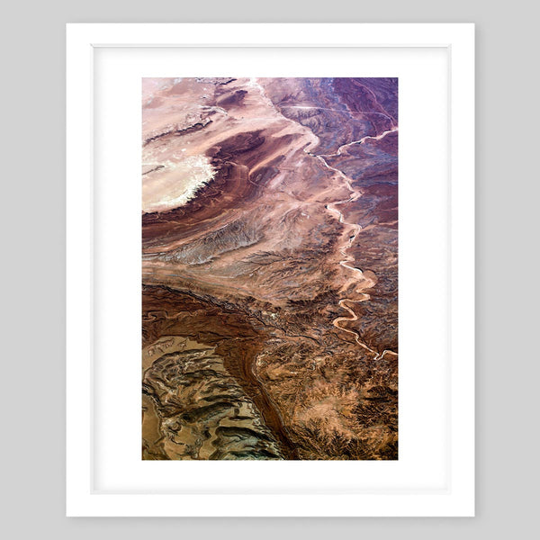 White framed art print of a photograph of a rock wall with different erosion