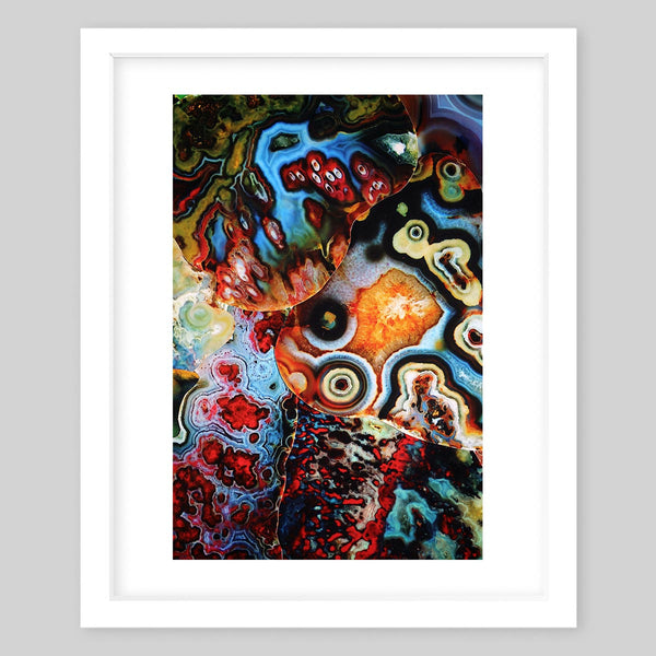 White framed art print of a photograph of many swirls of colors that formed into paisley patterns
