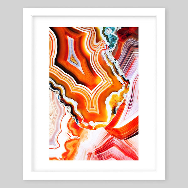 White framed art print of a photograph featuring many patterns of colors in warm tones