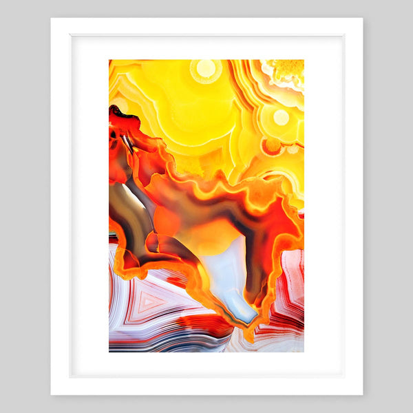 White framed art print of a photograph featuring many patterns of colors but primarily featuring yellow