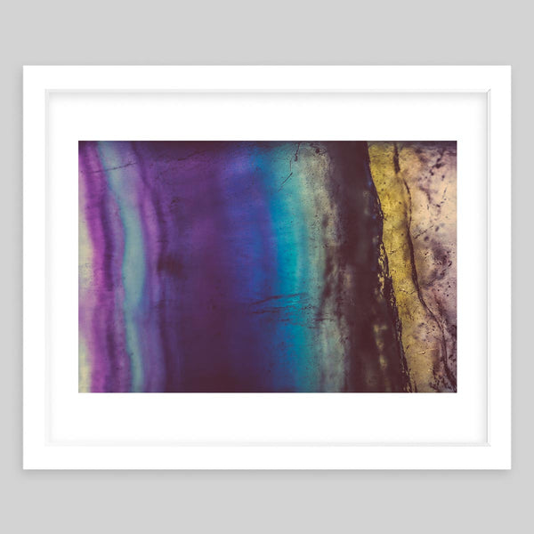 White framed art print of a close-up photograph of colorful glass or minerals