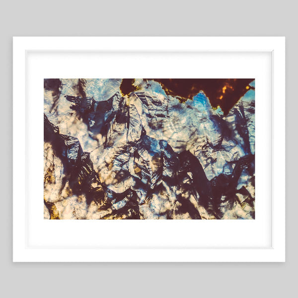 White framed art print of a close-up photograph of glass or minerals with water reflections